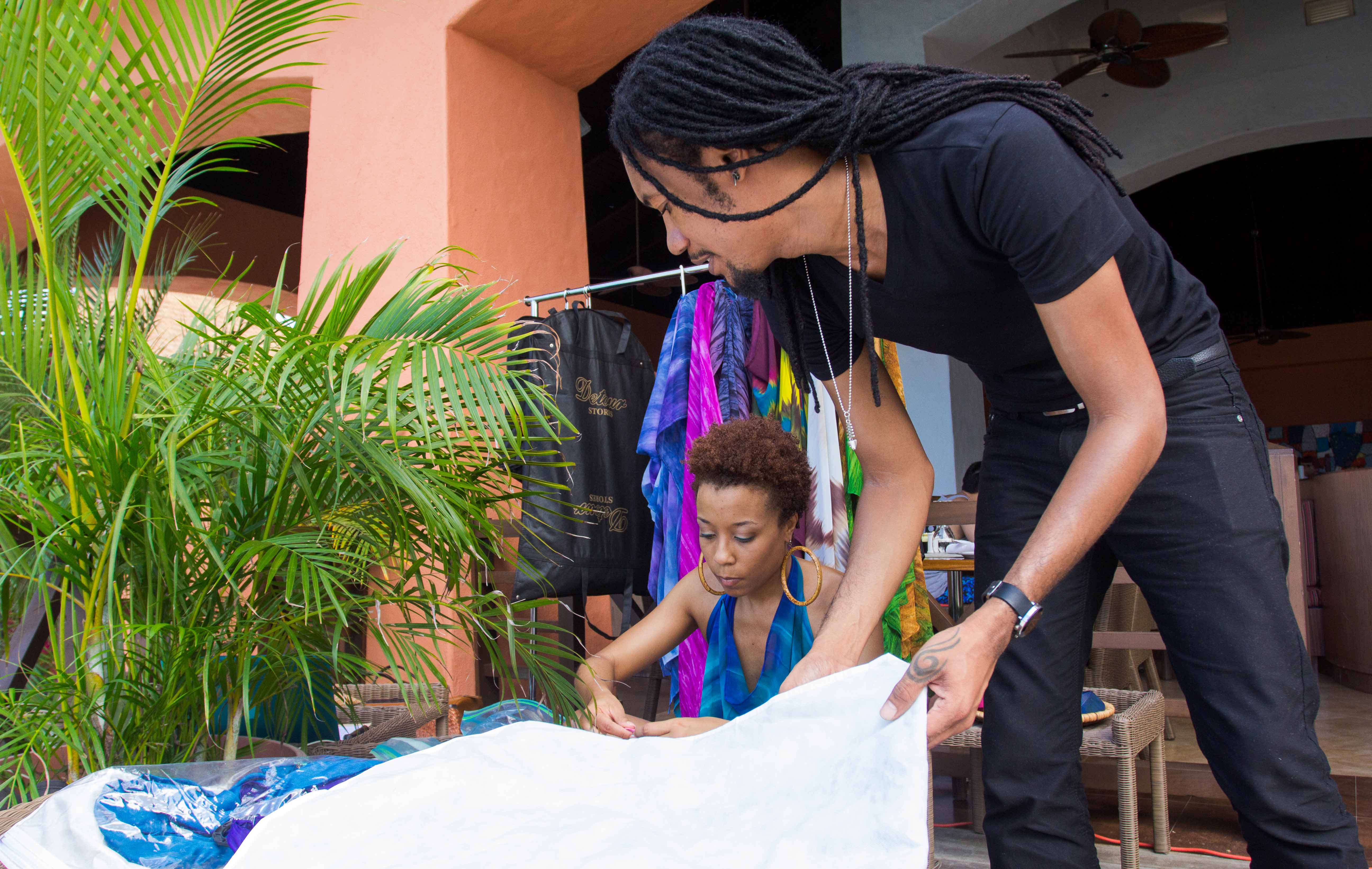 NOV 2012: Kaj's executive team, CEO/Director, Liza Miller, and President/Creative Director, Ayoung-Julien, prepare the Kaj space at the trunk show during the 2012 Ocean Style FashionShowcase in Montego Bay, Jamaica. Photo courtesy Mark Gellineau.