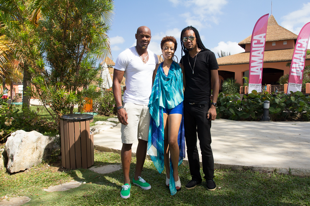 NOV 2012: Miller and Ayoung-Julien steal a photo opportunity with Jamaican star sprinter, Asafa Powell, at the 2012 Ocean Style FashionShowcase. Photo courtesy Mark Gellineau.