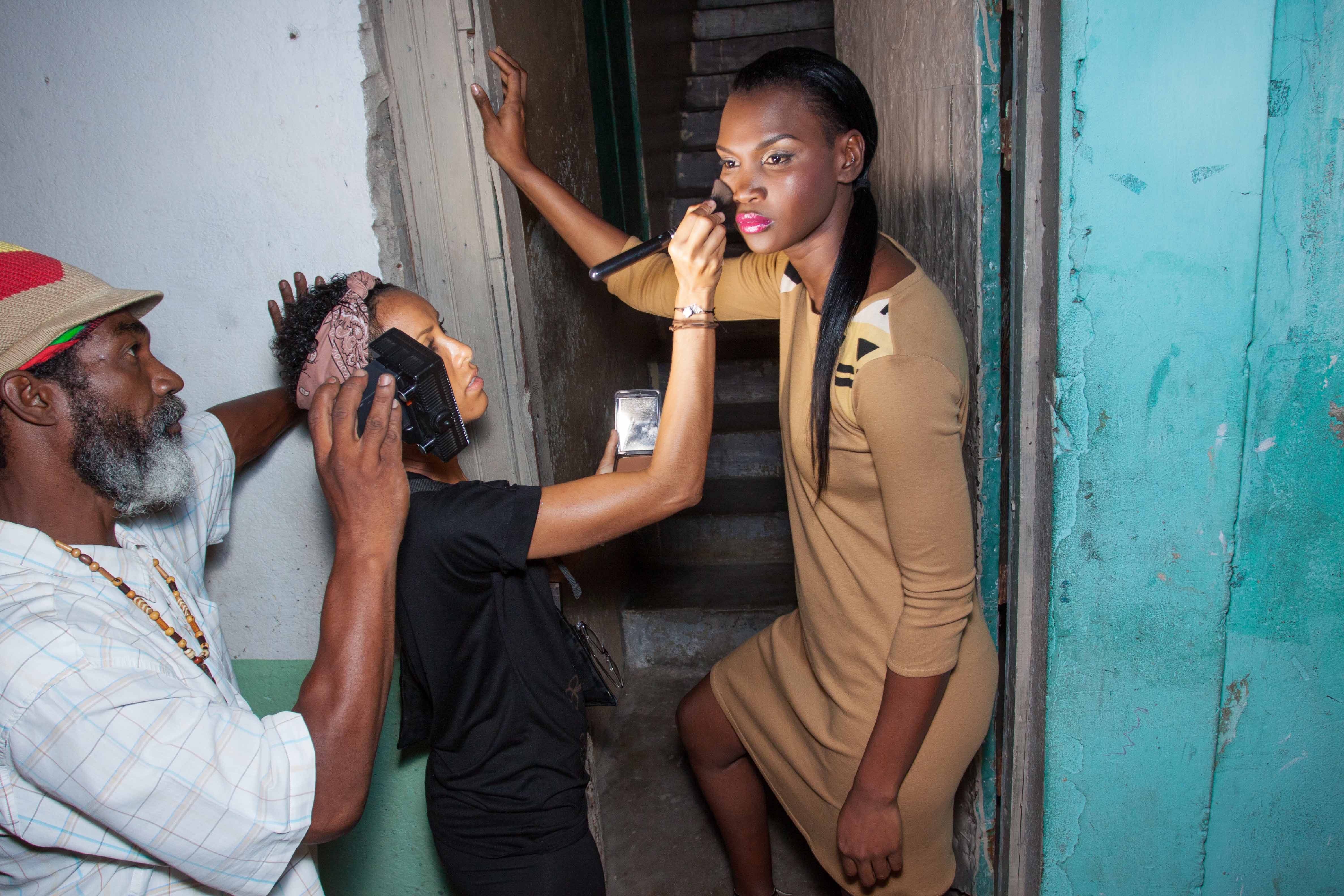 Model, Rochelle Watson, prepares for the camera as makeup artist, Loni Jones, applies finishing touches. Photo courtesy Mark Gellineau.