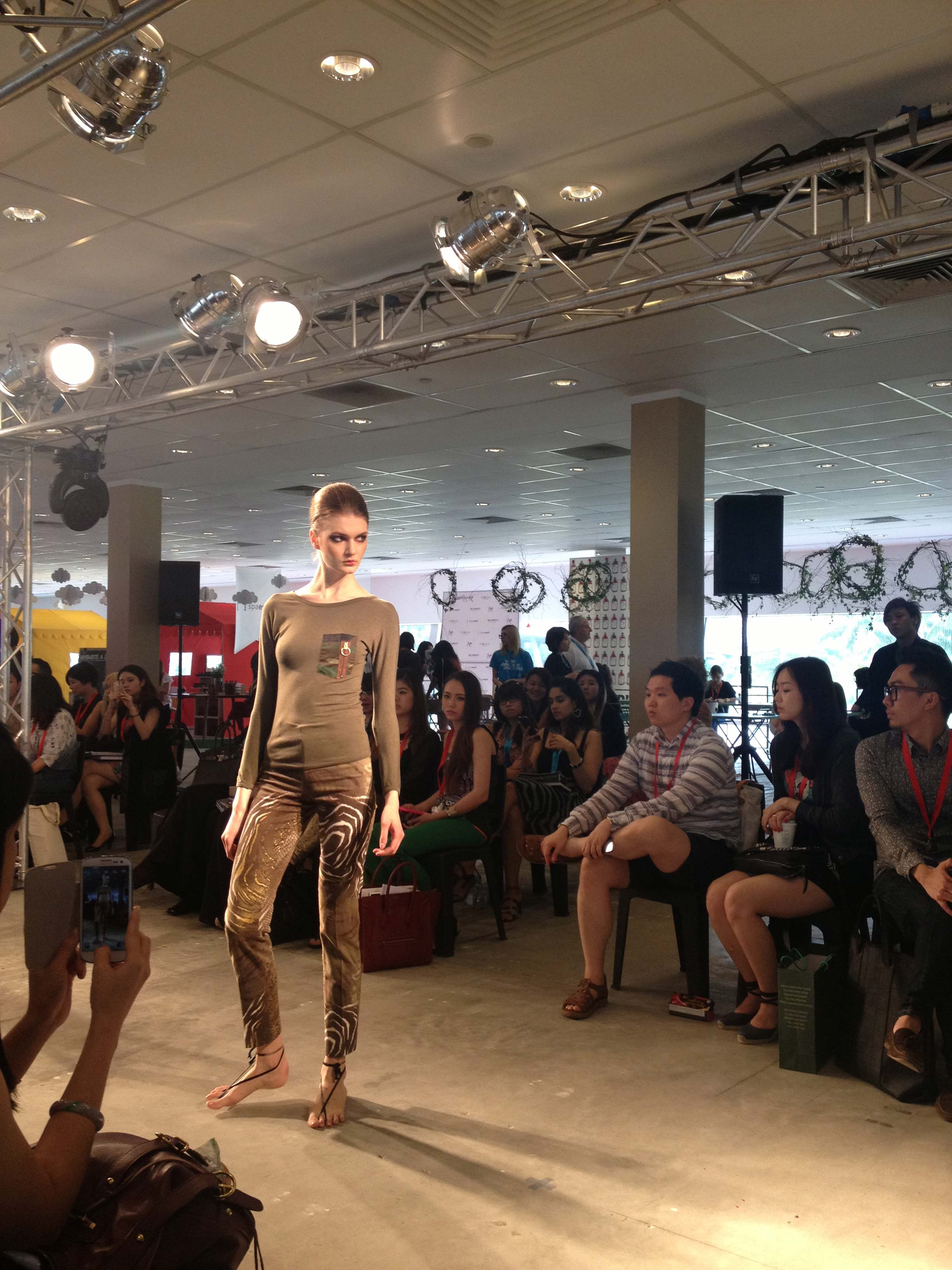 Tribu Sauvage makes its runway debut at BLUEPRINT during Singapore's fashion week, Asia Fashion Exchange (AFX). Magyar top with pocket accent and classic twill trousers.