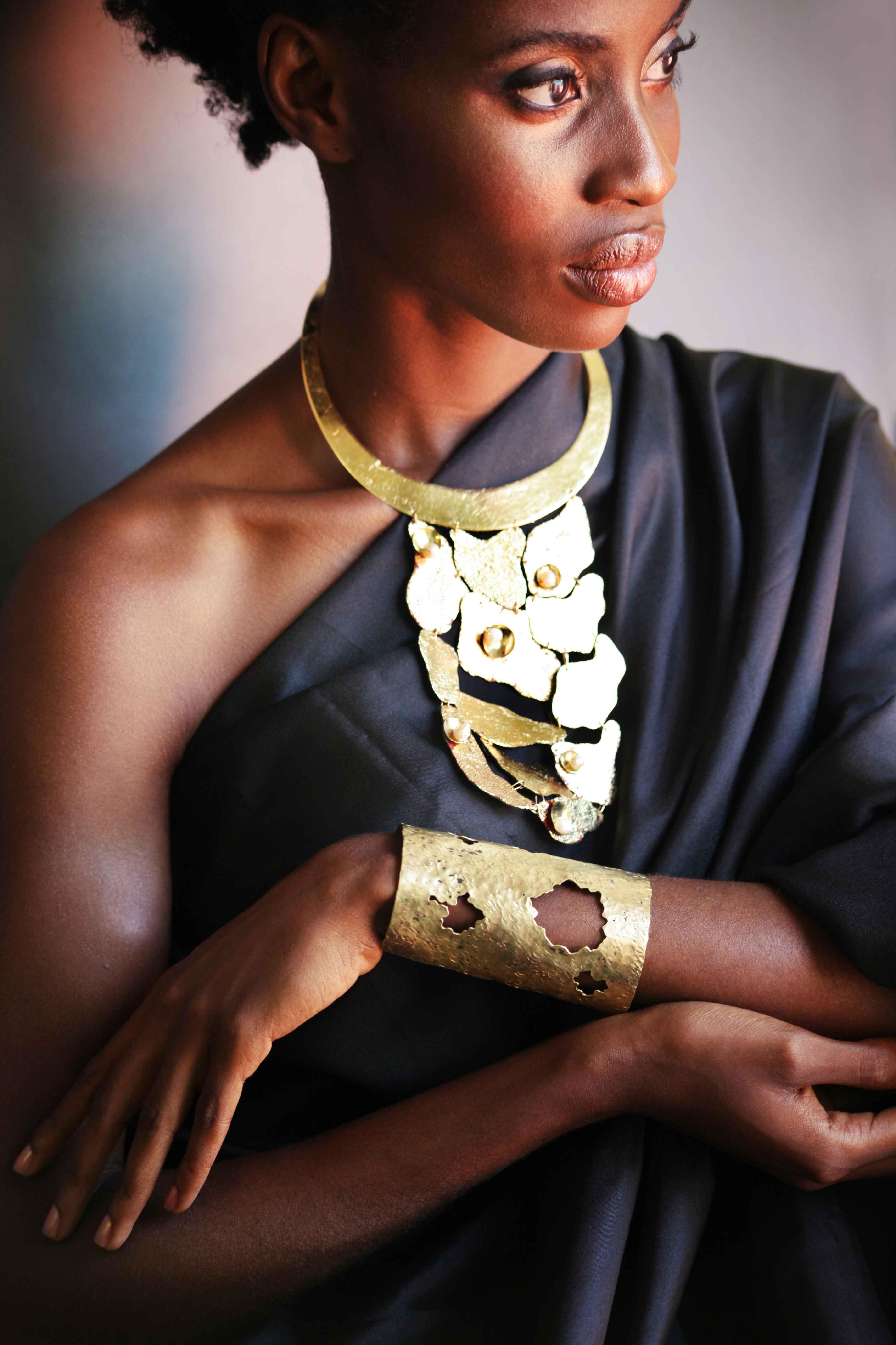 Popping gold statement necklace and cuff from Koko Karibi's Pangaea collection. Photo courtesy Koko Karibi.