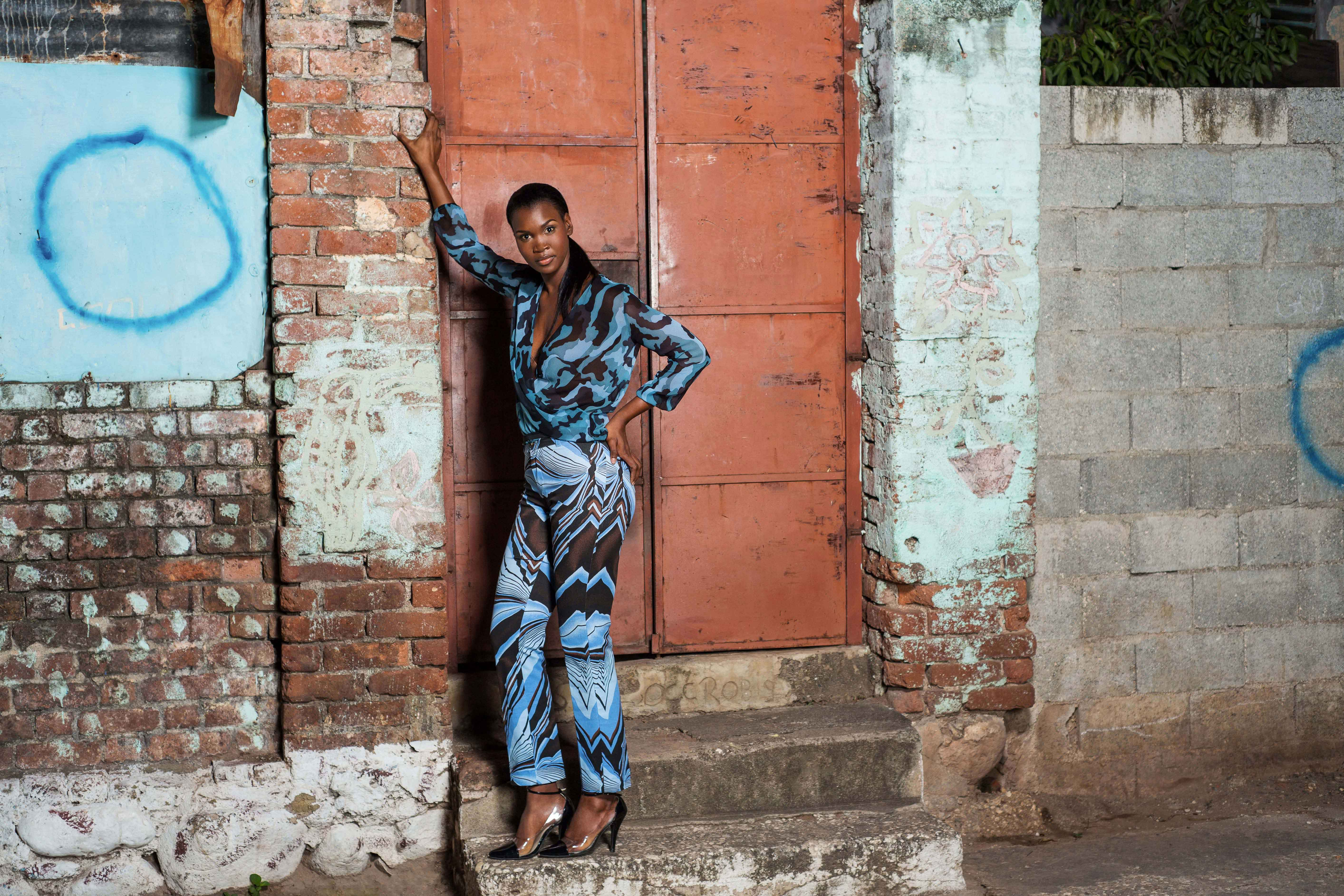 Wrap peasant blouse in silk with classic twill trousers in an eye-catching jazzy print. Photo courtesy Kaj Designs.