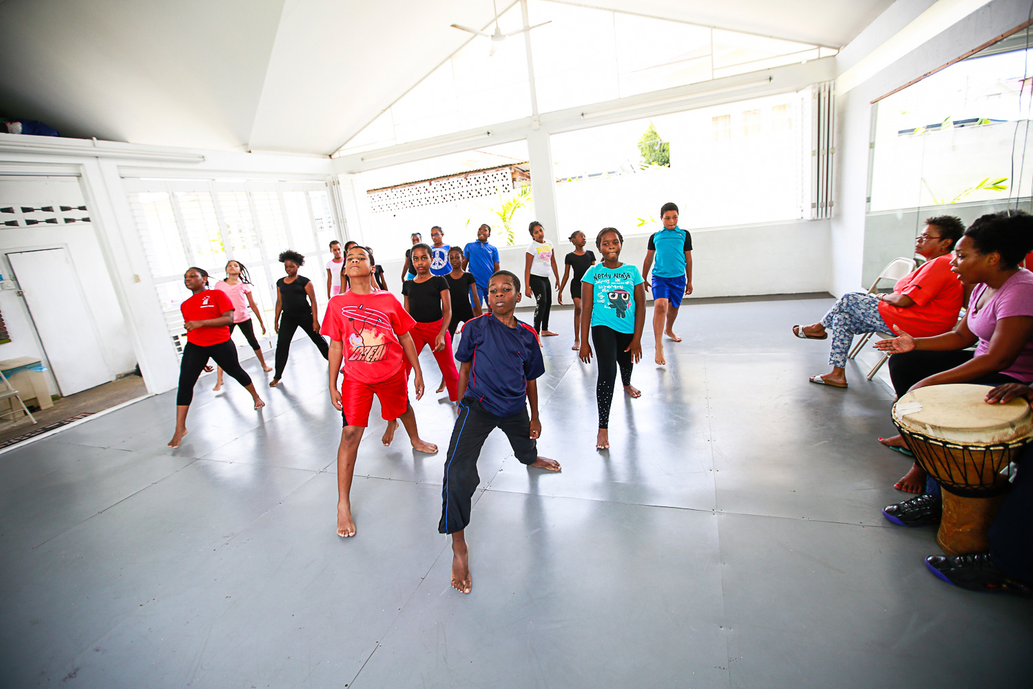 Artistic director, Noble Douglas, and dance and drama tutor, Tonya Evans, drill the young dancers in preparation for the stage. Photo courtesy Maria Nunes for Lilliput Children's Theatre.