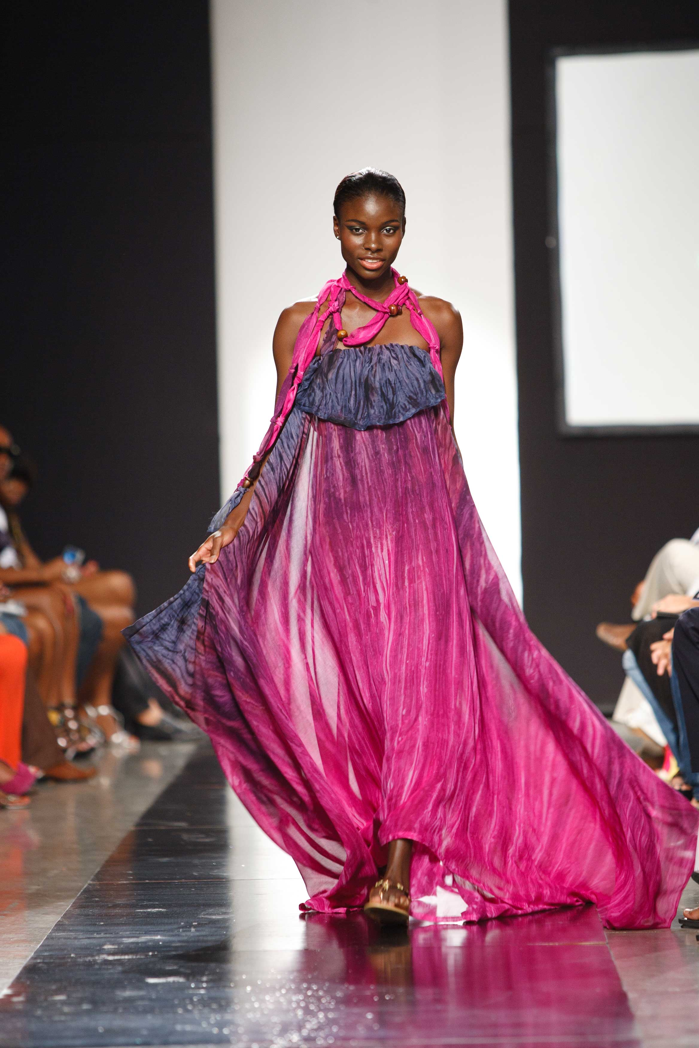 A captive audience was treated to the majesty of Kaj's sheer strapless Bohemian lounge dress, with wooden beaded fabric accents, at the 2010 CFW during the Shore Culture presentation. Photo courtesy Pulse Investments Limited.