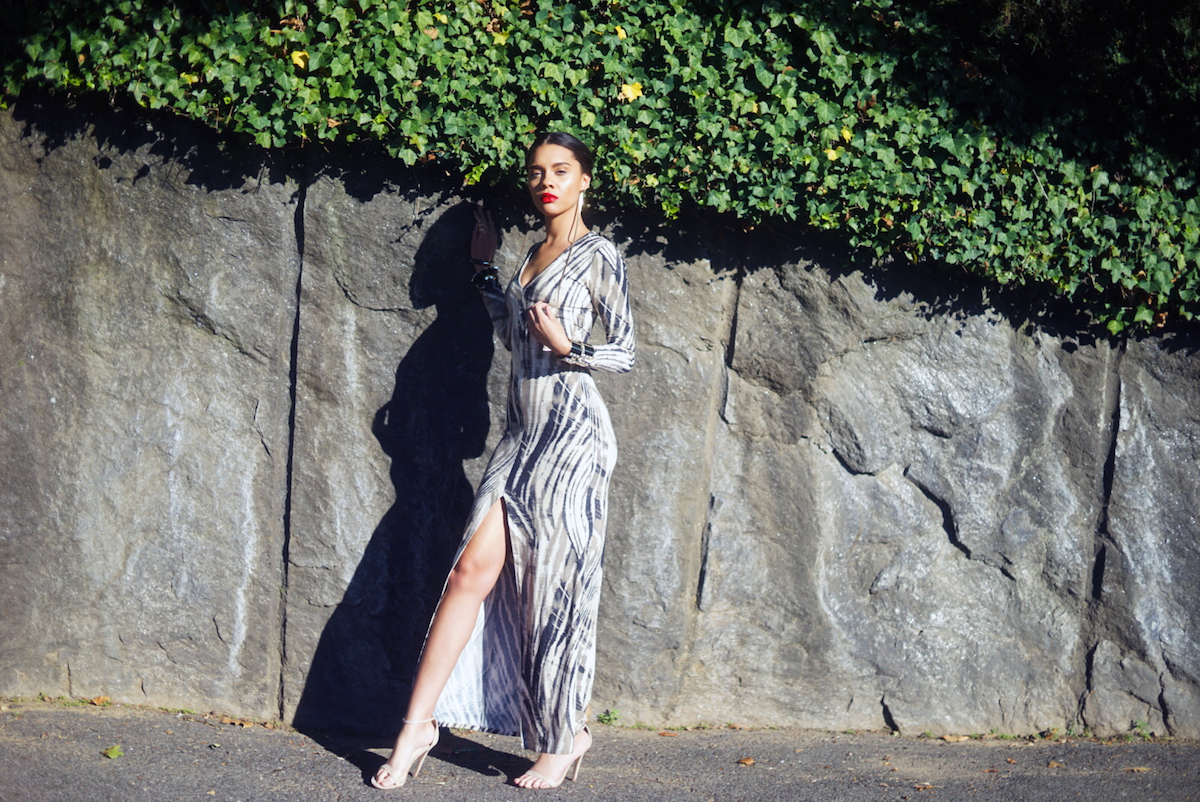The sensual tribal infusions of Kaj's long sleeved evening dress in a taupe, cream and black print captivate in the streets of New York City during a 2015 Global Runway promotional photo-shoot of the Tribu Sauvage resort collection. Photo courtesy Global Runway.